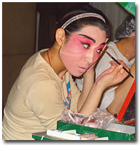 Applying the make up for the opera